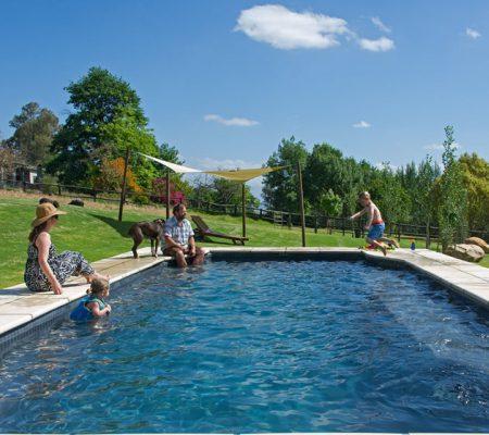 AfriCamps at Pat Busch Robertson Family enjoying pool