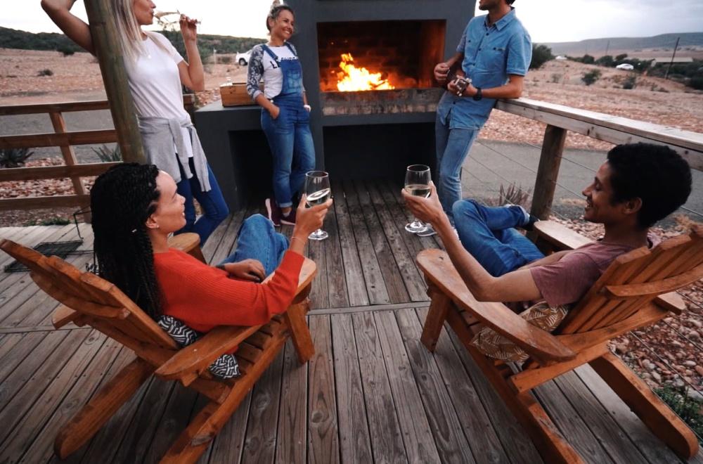 AfriCamps Klein Karoo Oudtshoorn Friends enjoying braai