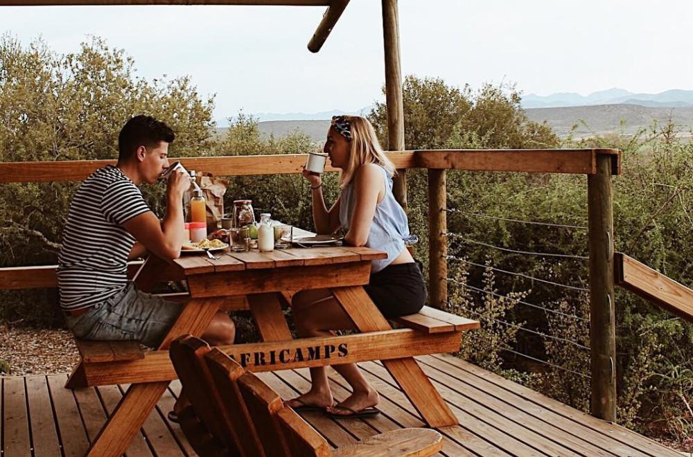 AfriCamps Klein Karoo Oudtshoorn Couple Enjoying Breakfast