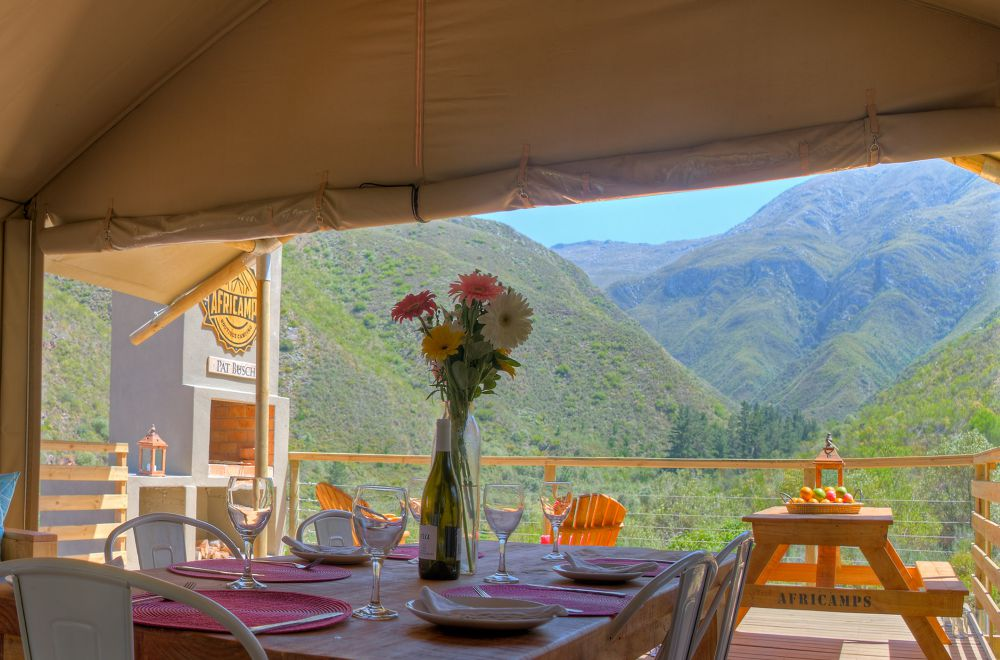 AfriCamps at Pat Busch Dining Table and View from Tent